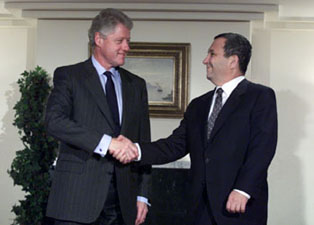 President Clinton shakes hands with Israeli Prime Minister Ehud Barak prior to their bilateral meeting.