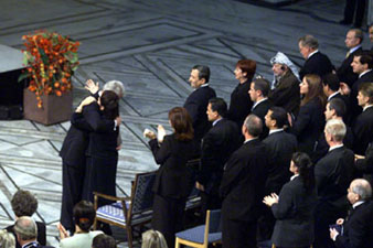 Leah Rabin embraces the President at the commemoration ceremony for her late husband.