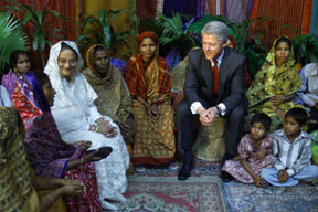 President Clinton and Prime Minister Sheikh Hasina participate in a microcredit event at the US embassy, Bangladesh.