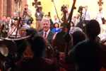 President Clinton smiles at a group of young musicians at the US Embassy event for the people of Joypura.