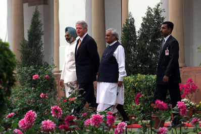 President Clinton and Prime Minister Atal Bihari Vajpayee stroll through the garden following their bilateral meeting en route to the signing ceremony at Hyderabad House, New Delhi.