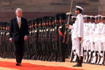 President Clinton reviews the troops during the arrival ceremony at the Rashtrapati Bhavan, New Delhi.