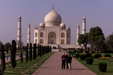The President and Chelsea Clinton listen to their tour guide at the Taj Mahal.  Agra, India.