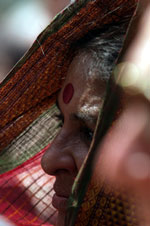 A woman listens to President Clinton's remarks at the US Ambassador's Reception, Roosevelt House, New Delhi.