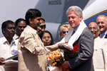 Chief Minister N. Chandrababu Naidu presents President Clinton with traditional items of greeting. Hyderabad Airport, India.