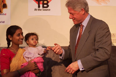 President Clinton greets Pushpalatha Balakrishna and her 9 month-old daughter Sandhya at Mahavir Trust Hospital.  Hyderabad, India.