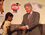 President Clinton administers polio immunization and tb treatment at Mahavir Trust Hospital.